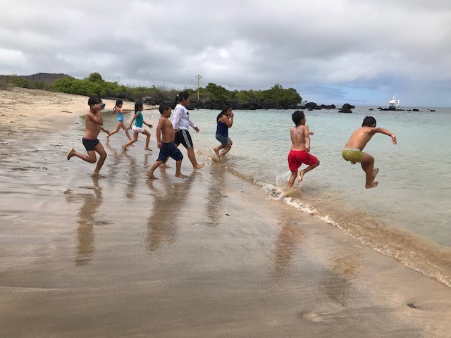 island-conservation-invasive-species-preventing-extinctions-floreana-community-kids-play